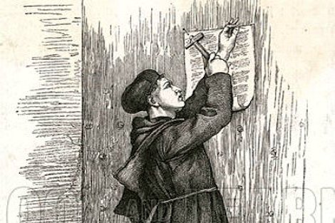 He nails up his 95 Theses or Propositions, attacking the Church's traffic in indulgences, on the door of All Saints' Church, Wittenberg. Date 31 October 1517.